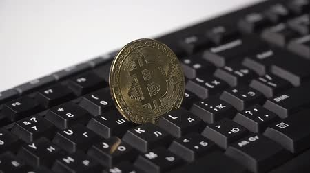 buy gold : Gold coin of the bitcoin revolves on the keyboard