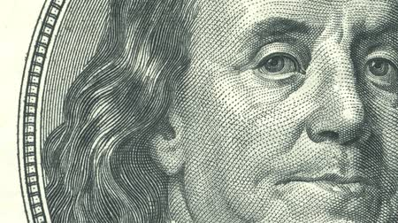 4 animaties close-up van Ben Franklin ons honderd dollarbiljet