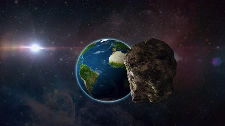 asteroid or meteor flies through space to earth, a few minutes before falling