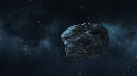 asteroid flies through space Stock Footage