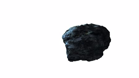 asteroid or meteorite, flying and rotating on a white background