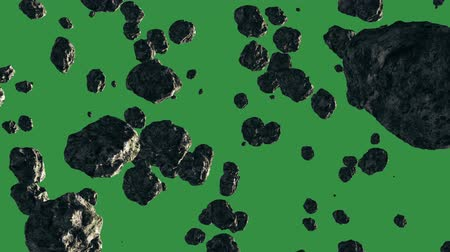 a group of asteroids or meteorites, flying and rotating, and on a white background Stock Footage