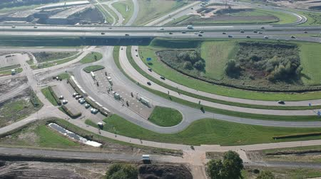 Флеволанд : Aerial view of traffic passing by Dutch highway A6 and exit Het Oor Almere