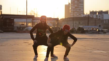 hiphop : Two little girls dancing in the street in sunset