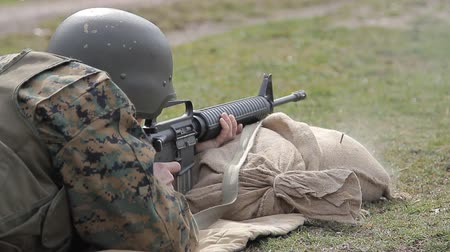 idf : An Bosnian defense forces soldier dressed in uniform shooting from M16 rifle