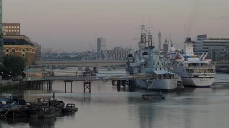 belfast : The warship and museum HMS Belfast with the German cruise liner Berlin moored alongside. Taken at dawn from Tower Bridge and shot in 4K original