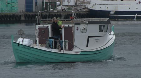 torshavn : Small fishing boat sailing in the harbour of Throshavn on the Faroe Islands Stock Footage