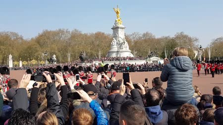 buckingham palace : London, United Kingdom - 15th April 2019. Changing of the guard ceremony on Buckingham palace. Stock Footage