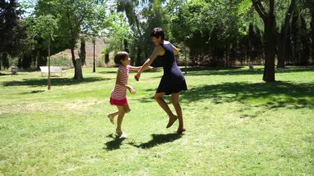 Mother and her daughter child girl playing and dancing together