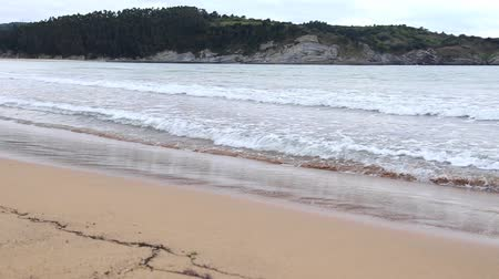 euskadi : The Beach of Gorliz, Basque Country, Spain, with the normal tide levels on a cloudy day.