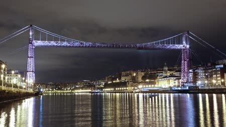 euskadi : Bizkaia Bridge at night, Biscay, Basque Country, Spain. Time lapse of the Hanging bridge, made in 1893, Unesco world heritage site.
