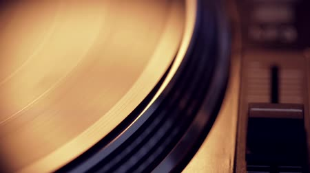 gravar : Spinning vinyl disc on retro turntable with pitch control in focus.Seamless loop with focus on the vinyl.