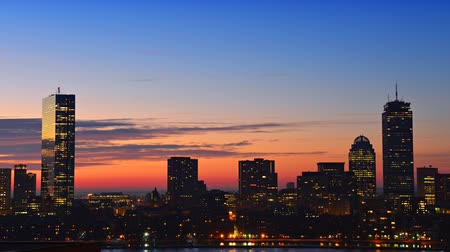 morning : Timelapse of dramatic sunrise over Boston downtown time lapse as seen from Cambridge