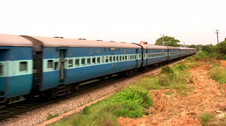bangalore : Indian passenger train passes by suburbs of Bangalore, Karnataka, India. Stock Footage