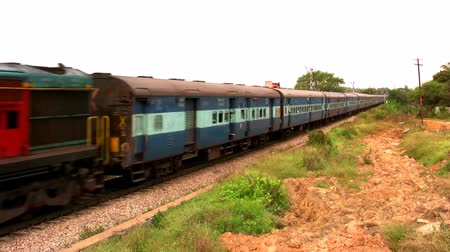 bangalore : BANGALORE, KARNATAKA, INDIA - DEC 12, 2007. Indian passenger train passes by suburbs of Bangalore, Karnataka, India. Stock Footage