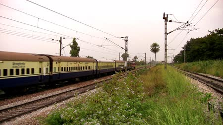 bangalore : Indian passenger train Shatabdi Express passes by suburbs of Bangalore, Karnataka, India.