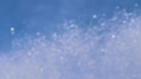 gush : Blurred sparkling spray from the fountain jet against the blue sky Stock Footage