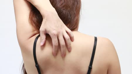 itchy : Woman scratching her back Stock Footage