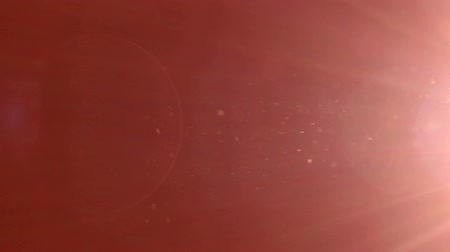 elétron : Moving particles blur on red background