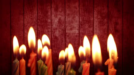 gyertyafény : birthday candles light on red wood background