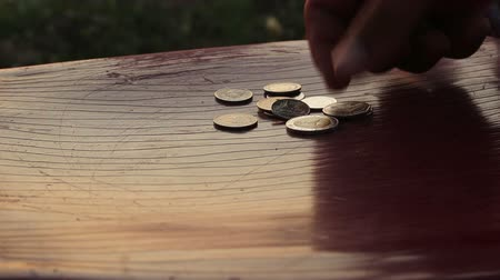 медь : man collect coins on table