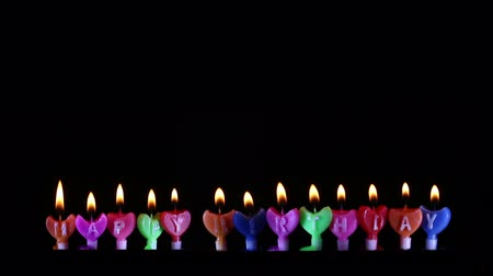 Happy Birthday candle Light on isolated black