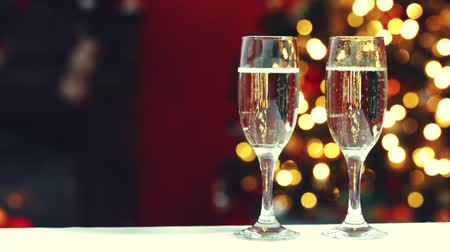 cozy : Room decorated for Christmas with two glasses of champagne Stock Footage