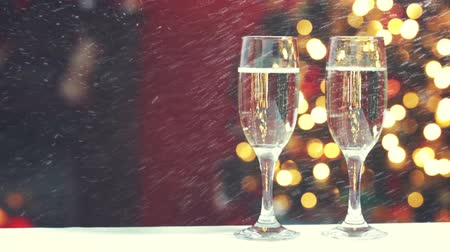 open hearth : Room decorated for Christmas with two glasses of champagne with falling snow