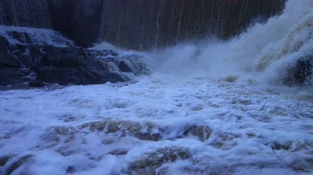 outpouring : Massive amount of water pours into the rocks over the dam in the mouth of Vantaa River at the Vanhankaupunginkoski rapids (Vanhankaupunginkosken putous) during a spring surge in March 2015.