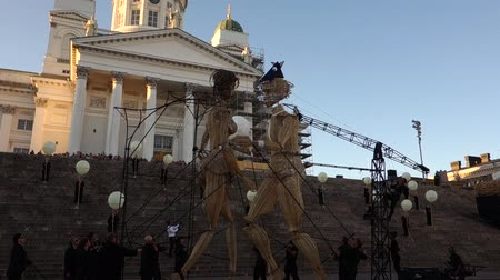 senate square : Helsinki, Finland - August 20, 2015 - Eight meters tall willow giants by artist group Cie lHomme debout in a performance at the Senate Square in the center of Helsinki, Finland at the annual Night of Arts event which is part of the Helsinki Festival runn