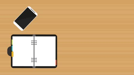 Notebook open with pen and smartphone over wooden background, hd animation