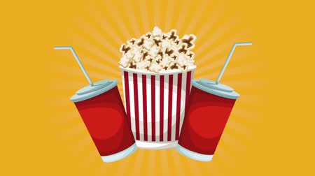 filme : Pop corn and soda cups over yellow background Stock Footage