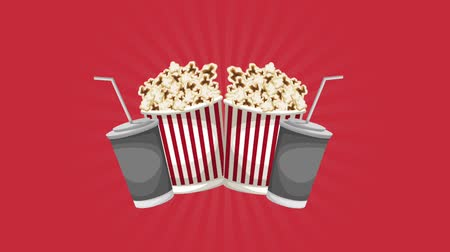 tuzlu : Pop corn boxes and soda cups over red background