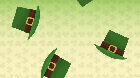 st patrick : Elf hats falling over green clovers background High definition animation colorful scenes Stock Footage