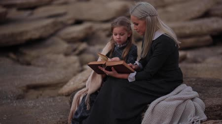 bulanık : Woman reading in the evening Stok Video