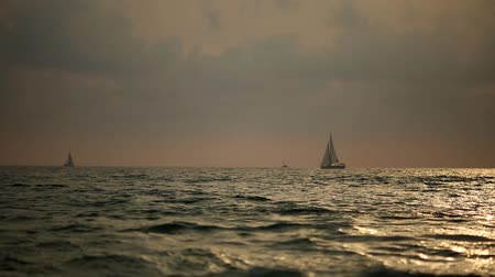 restless : The sea and a pleasure yacht. A glittering sunset