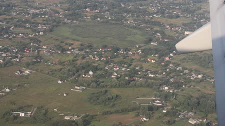 clareza : Flying over the green landscape with river, green fields, forest and countryside Stock Footage