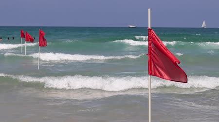 ter cuidado : Red flag on sand beach for warning of dangerous of swimming in the sea, Mediterranean sea