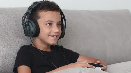Boy Playing Video Games On The Console The On The Sofa At Home Stok Video