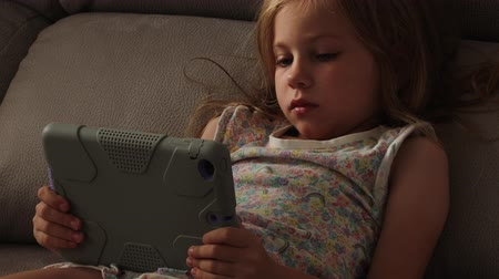 napping : Beautiful little girl with gadget in bed at night. Bedtime schedule