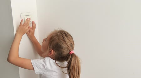Energy saving concept., Child learning turn on and turn off light switch in home. kid learning