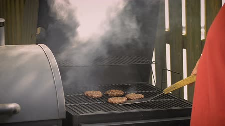 Barbecue burgers on charcoal grill in summer