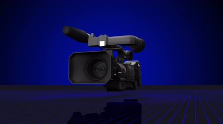 1080p HD video of a video camera. Camera pans and flies into viewfinder. Vídeos