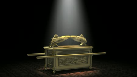 1080p HD stock video of the ancient Ark of the Covenant Artifact, rotating then pulses light.