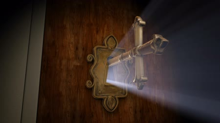 HD 1080p stock video showing close-up of a cross shaped key moving towards the key hole and then opening the door.