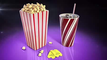 A 1080p HD stock video of popcorn, soda and 2 movie tickets on a flashy reflective surface showing flashes of light from all around while the camera slowly pans around.