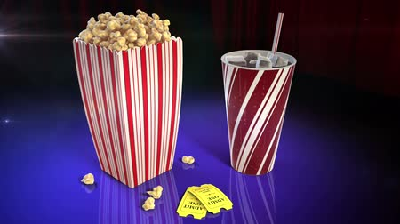 jídla : A 1080p HD stock video of popcorn, soda and 2 movie tickets on a flashy reflective surface showing flashes of light from all around while the camera slowly pans around.