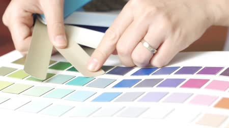 paleta : Asian woman interior designer working with color samples for selection and typing on laptop computer keyboard. Wideo