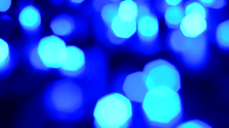 мягкий : blue color tone bokeh lights blur with slow and fast blinking on black background