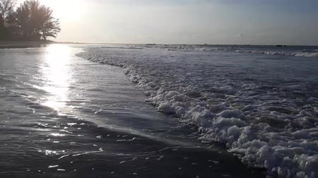 океаны : Sunset on the beach, waves slowly splashing on the sand